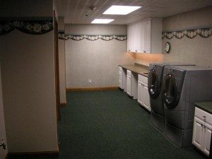 Awesome Laundry Room with sewing desk and craft workstations