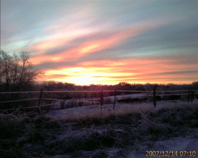 sunrise-above-icy-barb-wire-1